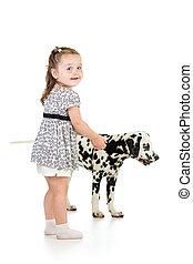 kid girl playing with dog