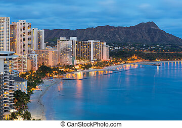 Honolulu city and Waikiki Beach at night - Scenic view of...