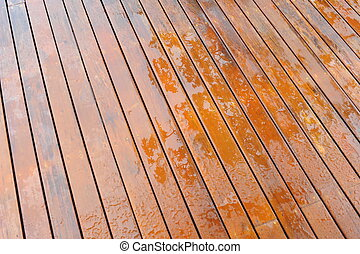 Wet wooden floor during rain