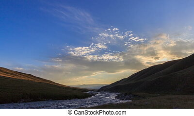 Sunset in the mountains. River Valley Tuz - The sun is...