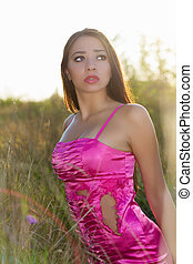 Brunette wearing torn dress - Young frightened brunette...