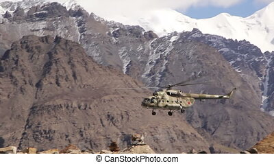 Helicopter sits in the mountains - The helicopter sits in...