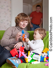 mother and child plays with toys