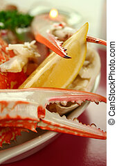 Cracked Sand Crab - Fresh cracked crab claw with a slice of...
