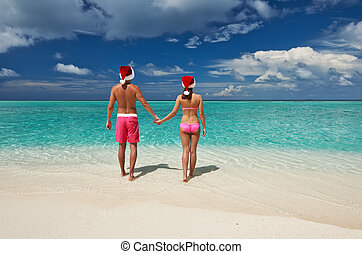 Couple in santa's hat on a beach at Maldives - Couple in...