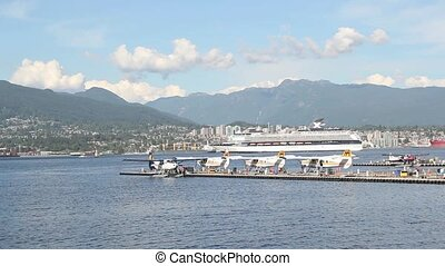 Seaplane Docks with Float Planes Moving Cruise Ship and Sea...