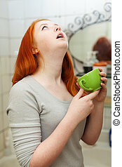 Teen girl gargling throat in bathroom - Colds teenager with...