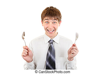Happy Teenager with Cutlery. Isolated on the White...