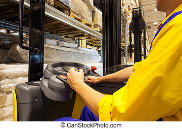 Forklift operator - Closeup of a fork-lift operator at work