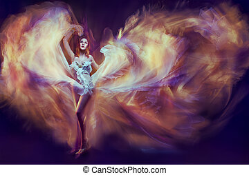 Woman in waving dress as a flame dancing with flying fabric. Dark background