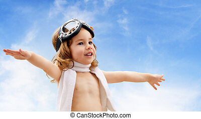 airplane pilot - A child plays an airplane pilot