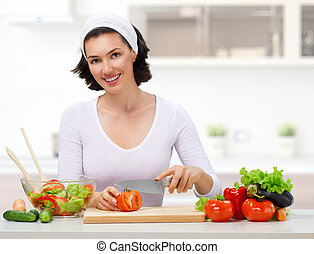 healthy food - woman in kitchen making salad