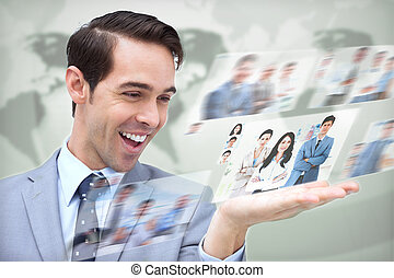 Content businessman looking at pictures on digital screen on...