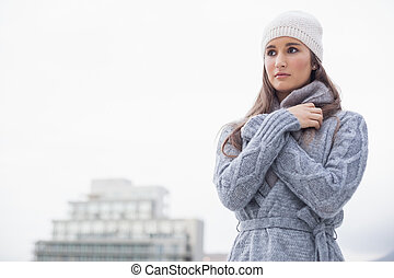 Cold pretty woman with winter clothes on posing - Pretty...