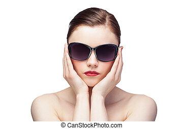 Glamorous model wearing stylish sunglasses on white...