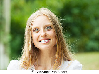 ordinary middle-aged woman against nature background