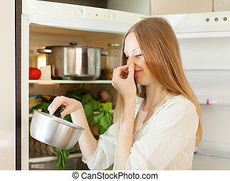 woman holding her nose because of bad smell - Long-haired...