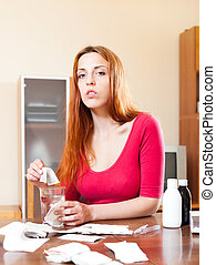 Young sick woman makes herself tea
