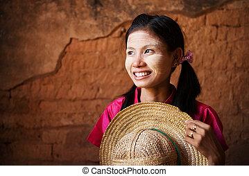 Traditional Myanmar girl looking away.