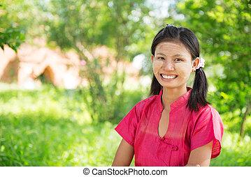 Myanmar girl standing outdoor.