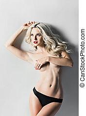 Closeup studio portrait of sexy blonde girl in panties -...