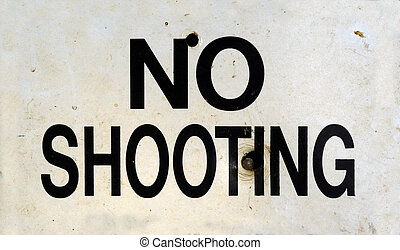 No Shooting Sign - Grungy No Shooting Sign With Bullet Holes