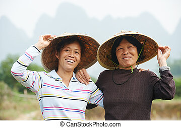 chinese agricultural farm workers - Smiling chinese asian...