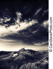 Bromo mountain under cloudy sky