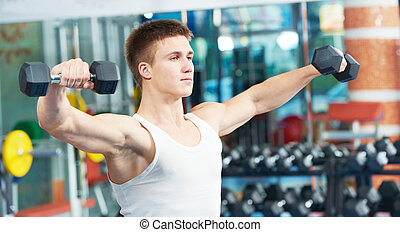 bodybuilder man training with dumbbells