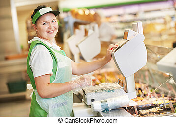 saleswoman in supermarket shop - Smiling saleswoman...