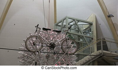 metal ball bicycle on a tightrope