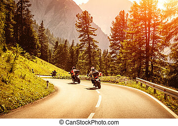 Group of motorcyclists on mountainous road - Group of...