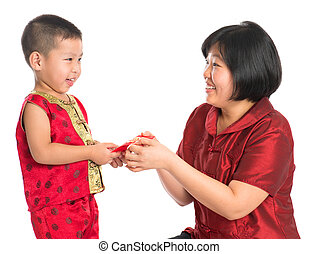 Chinese New Year celebration - Asian Chinese boy receiving...