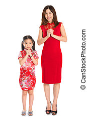 Full body Chinese parent and child greeting to each other