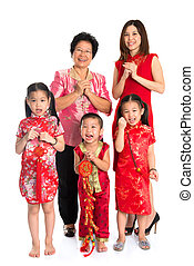Asian Chinese family greeting on Chinese New Year - Group of...