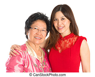 Asian senior mother and adult daughter