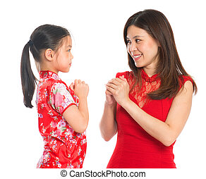 Chinese parent and child greeting to each other - Happy...