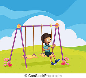 A young boy swinging