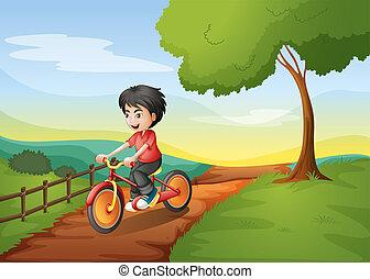 A happy boy biking