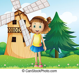 A young girl near the farmhouse with a windmill