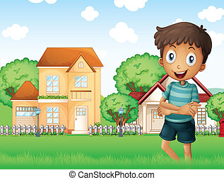A smiling boy standing in front of the neighborhood -...
