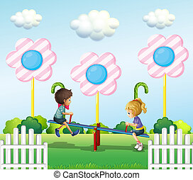 Kids playing seesaw at the park