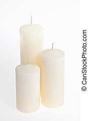 Candles on white - Three new white candles of various height