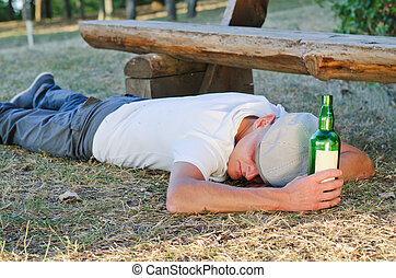 Drunk man lying on the ground - Drunk man lying on his...