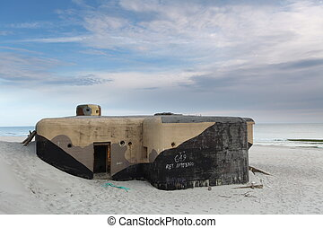 Bunker on beach in sunrise