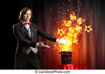 Magician with hat - Image of magician showing tricks with...