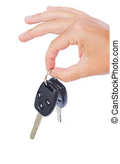 hand holding a car keys isolated on white background
