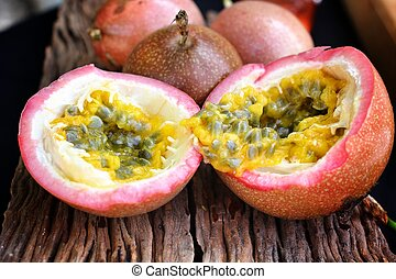Passion fruit on wood background