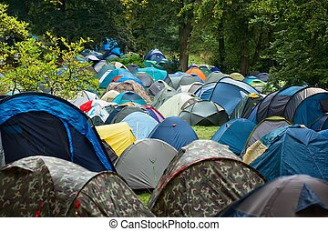 Many tents in nature - Many tents at a festival campsite