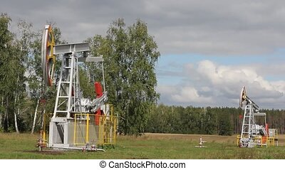 Oil pump working in the forest Oil industry equipment